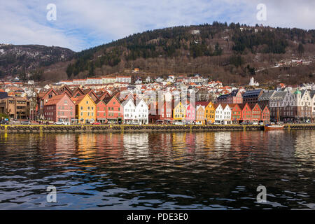 Bryggen, Bergen, Norway taken from a boat in the harbour in the morning. - Stock Image
