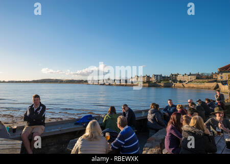 Afternoon drinks at the Ship Inn beer garden in Elie, Fife, Scotland, UK - Stock Image
