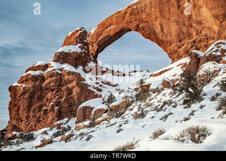 South Window Arch under snow, The Windows, Arches National Park, Moab, Utah USA - Stock Image