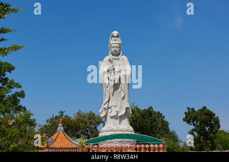 Very large statue of Buddhist goddess of mercy Guanyin, in Kuang Im Chapel, near River Kwai, in Kanchanaburi, Thailand. - Stock Image