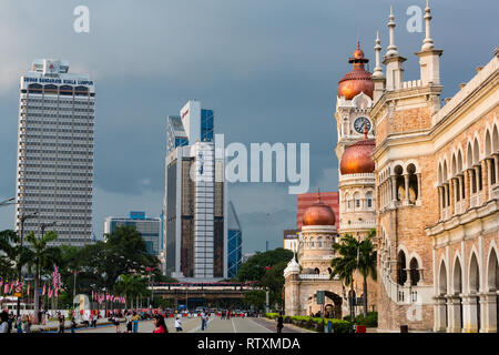 Juxtaposition of Modern Highrise Office Buildings with British Colonial Era Moorish Architecture.  Sultan Abdul Samad Building on right, former seat o - Stock Image