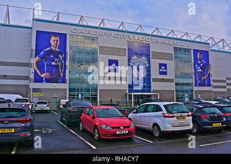 View of front entrance to the Cardiff City Football Club Stadium at Leckwith on the outskirts of Cardiff.Cars parked outside. - Stock Image