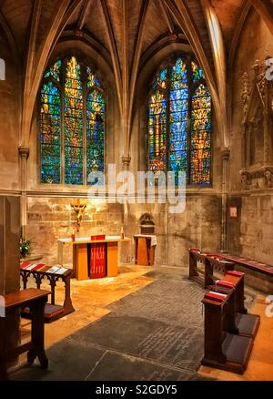 The Chapel Of St. Catherine and St. JOHN inside Tewkesbury Abbey, Gloucestershire, England, UK. The colourful stained glass Denny Windows were installed in 2002. Photo © COLIN HOSKINS. - Stock Image
