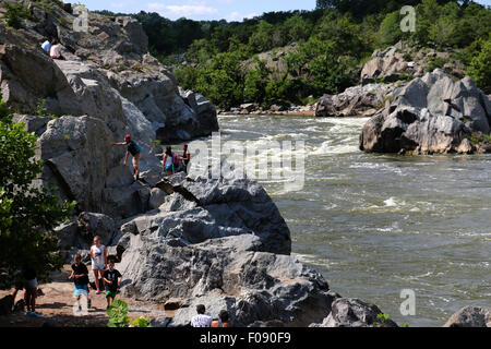 Hikers on rocks at the Great Falls of the Potomac River Maryland - Stock Image