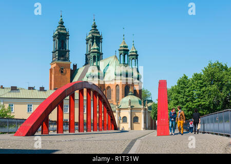 Poznan Cathedral Island, view of Poznan Cathedral from the eastern end of the red Tumski Bridge (Most Biskupa Jordana), Ostrow Tumski, Poznan, Poland. - Stock Image