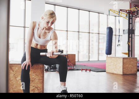 Active girl in fitness gym. Concept workout healthy lifestyle sport - Stock Image