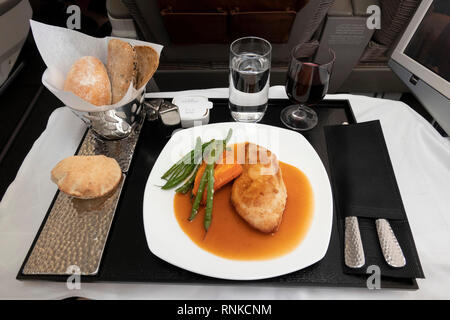 Air Travel, Etihad Airways Boeing 777-300, Business Class in flight meal, low carbohydrate lunch, grilled chicken with carrot and green beans - Stock Image