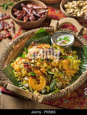 South Indian prawn biryani. Spicy shrimp and rice dish. India Food - Stock Image