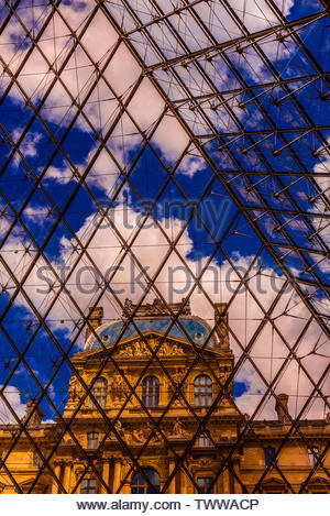 Inside the glass Louvre Pyramid, designed by I. M. Pei (this is the main entrance to the Louvre Museum), Paris,  France. - Stock Image