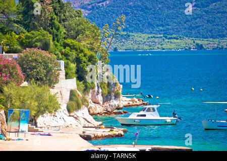 Brodarica village beach and stone coastline view, Sibenik archipelago, Dalmatia region of Croatia - Stock Image