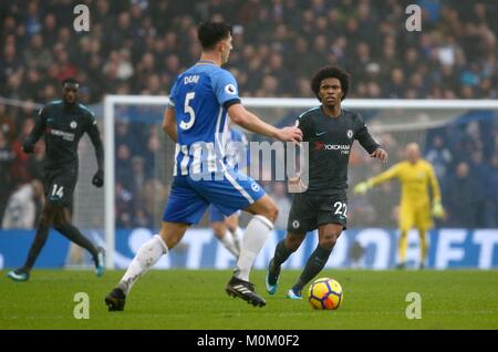 Willian of Chelsea looks on as Lewis Dunk of Brighton holds onto the ball during the Premier League match between - Stock Image