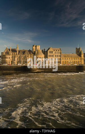An aerial view of the iconic sandstone architecture of the Victorian era  'Old College' building of the  University on the seafront at Aberystwyth [made by a CAA licenced drone operator]. The building is the subject of a multi-million pound redevelopment plan to make it a cultural centre for the town - Stock Image