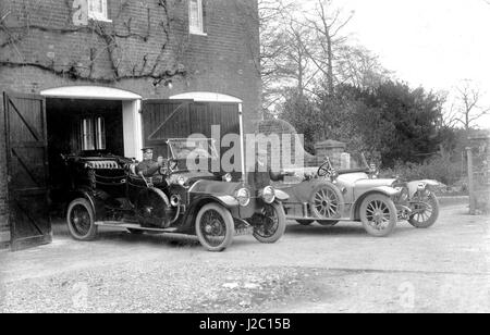 Two Vintage Cars at Country House with Chauffeurs - Stock Image