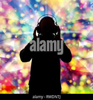 silhouette of a man with headphone listening music - Stock Image