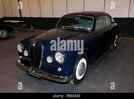 Three-quarter Front-View of a 1955 Lancia Aurelia B20 Coupe 2.5,on display in the Paddock Area of the 2019 London Classic Car Show - Stock Image
