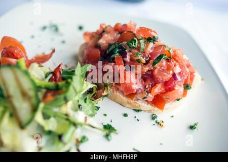 Italian Food in Restaurant - Stock Image