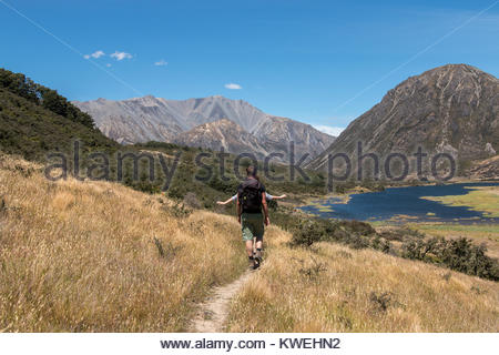 Young couple on walking trail, Canterbury, New Zealand - Stock Image