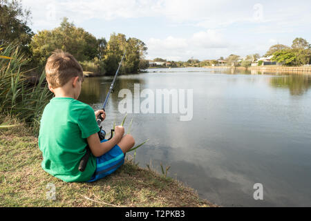 6 year old boy fishing at a local pond. Beachmere Queensland Australia. - Stock Image