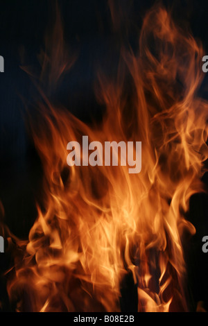 Wavy lengths of fire consume the air. - Stock Image