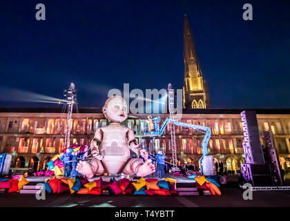 A dress rehearsal for Zara, a huge outdoor theatre production featuring a Giant baby, at the Piece Hall in Halifax, Yorkshire. - Stock Image