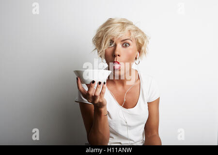 Portrait Young Blonde Head Female Perfect Skin Holding Hands White Bowl Copy Space Wall Your Business Information - Stock Image