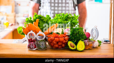 Table full of vegetarian vegetables food ready to be eat and cooked - concept of home kitchen and restaurant chef - mixed colors with seasonal raw ing - Stock Image