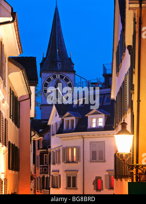 Switzerland, Zurich,Old Town Zurich, street scene with view of St. Peter's Church clock tower at dusk - Stock Image
