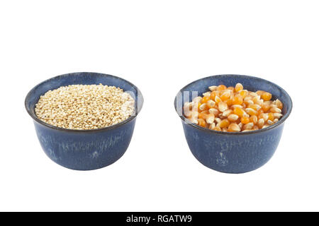 Small bowls of organic quinoa and popcorn. - Stock Image