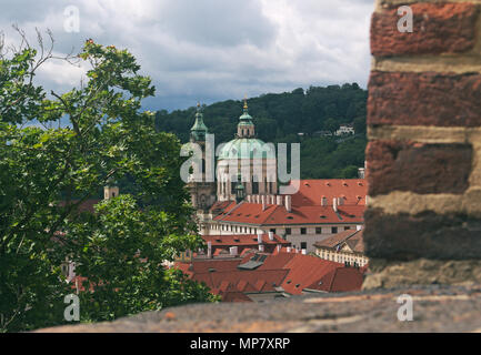 view of of St. Nicholas Church from the Prague Castle, Prague Czech Republic - Stock Image