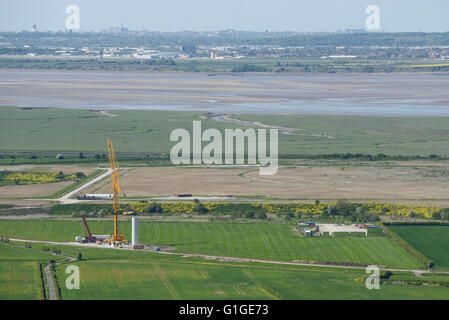 View across the Mersey Estuary from Helsby Hill towards Liverpool with construction of the Frodsham Wind Farm project - Stock Image