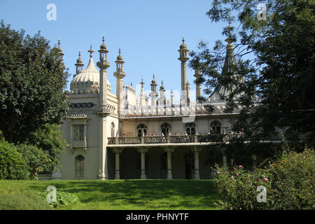 Brighton, UK - September 1 2018: People on a balcony on the Brighton Pavilion on a sunny day on 1​ September 2018.   The Pier, in the central waterfront section, opened in 1899 houses amusement rides as well as food kiosks .Credit: David Mbiyu/Alamy Live News - Stock Image