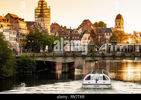 Strasbourg, Alsace, France, Batorama sightseeing river cruise boat, Ill river, Pont Royal bridge, tram stop, late afternoon light, - Stock Image