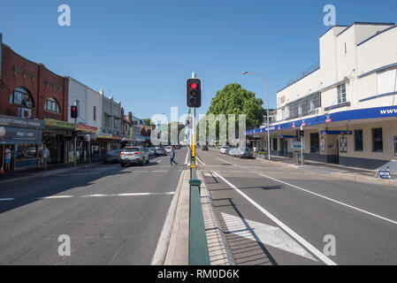 A set of traffic lights and a level crossing on Botany Road in the shopping area of the Sydney suburb of Mascot - Stock Image