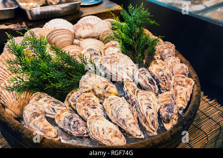 Fresh oyster on ice as street food at Nishiki market, Kyoto, Japan - Stock Image