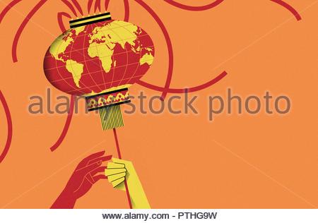 Hands exchanging globe Chinese lantern - Stock Image