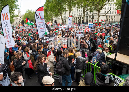 London, UK. May 11th 2019. National Demonstration for Palestine. Thousands of activists marched from Portland Place to Whitehall. Organised by the Palestine Solidarity Campaign, Stop the War Coalition, Palestinian Forum in Britain, Friends of Al- Aqsa & Muslim Association of Britain. Pictured, protesters in Whitehall. Credit: Stephen Bell/Alamy Stock Photo - Stock Image