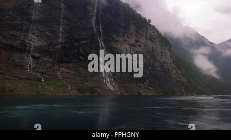 The Seven Sisters or 'Dei sju systre' waterfall that lies directly across 'Friaren' or The Suitor waterfall, Geirangerfjord, Norway - Stock Image