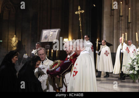 Veneration of the Holy Crown of Thorns in the Notre-Dame Cathedral (Notre-Dame de Paris) in Paris, France. People - Stock Image