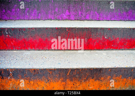 Purple Orange and Red painted steps - Stock Image