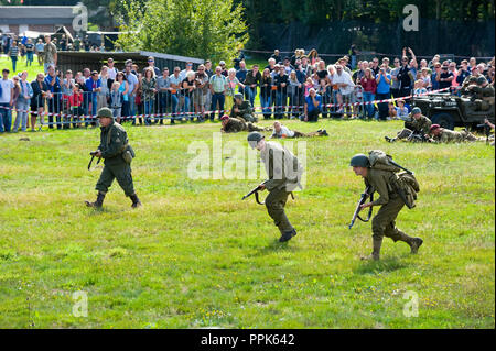 ENSCHEDE, THE NETHERLANDS - 01 SEPT, 2018: Soldiers fighting and shooting during a military army show for public. - Stock Image