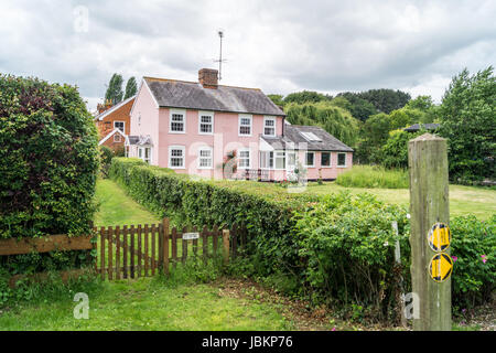 A pink cottage, Pin Mill, Suffolk, England - Stock Image