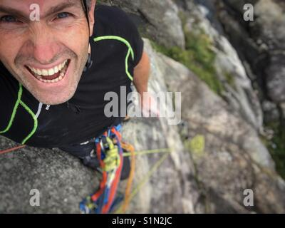 Man climber taking a selfie. - Stock Image