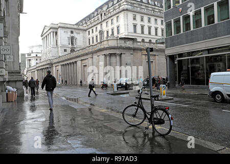View of the Bank of England in the City of London and street scene with bike and people walking in Threadneedle Street England UK  KATHY DEWITT - Stock Image