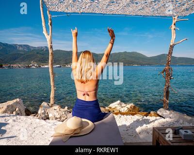 Good looking woman in bathing suit at the beach in Limenaria, Thasos, Greece - Stock Image