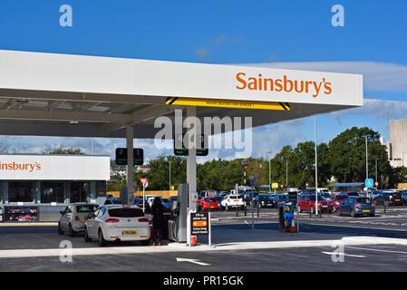 Filling station at Sainsbury's  and Argos Supermarket. Shap Road, Kendal, Cumbria, England, United Kingdom, Europe. - Stock Image