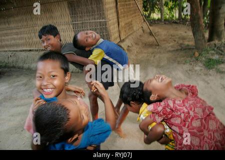 BANGLADESH Children belonging to the Garo tribal minority, Haluaghat, Mymensingh region photo by Sean Sprague - Stock Image