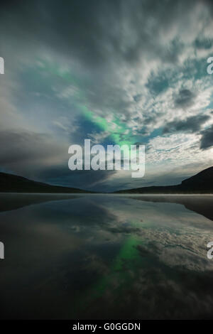 Northern Lights and moonlight over lake Abeskojavri - Abiskojaure, Kungsleden trail, Lapland, Sweden - Stock Image