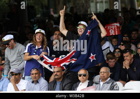 London, UK. 14th July, 2019.  ICC World Cup Cricket Final, England versus New Zealand; New Zealand supporters cheer as four runs are made by James Neesham Credit: Action Plus Sports Images/Alamy Live News - Stock Image