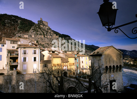 The village and castle of Entreveux, Provence from across the river. - Stock Image