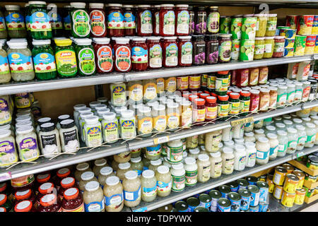 Orlando Florida Little Saigon Phuoc-Loc-Tho oriental market Asian general grocery store supermarket shelves imports glass jars Macapuno Kaong sugar pa - Stock Image